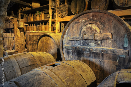 Oak barrels with the wine at the cellar Poster