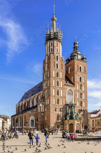Fotobehang Krakau KRAKOW, POLAND - FEBRUARY 27, 2017: Mariacki church, Church of Our Lady Assumed into Heaven, a brick gothic church adjacent to the Main Market Square