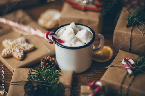 Foto op Plexiglas Chocolade Cup of hot chocolate with marshmallows on wooden table with Christmas gifts