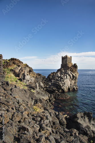 Fototapeta ancient watchtower in lava stone in Sicily