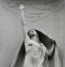 Statue Of A Woman Reaching Up ...
