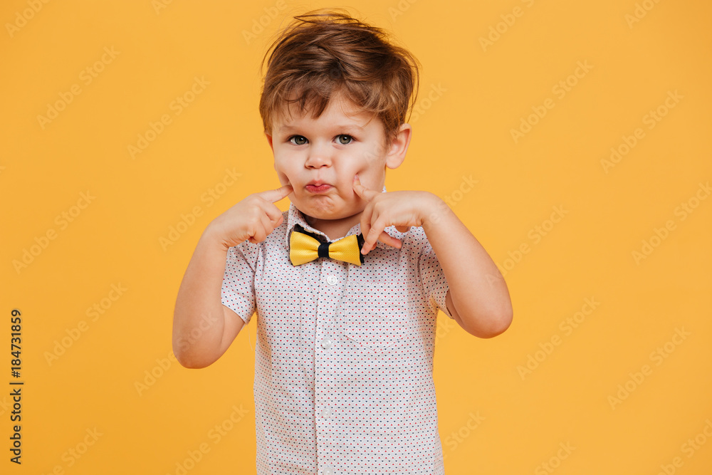 Fototapety, obrazy: Funny little boy child standing isolated