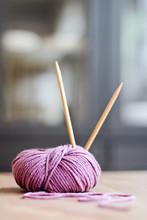 Purple Ball Of Yarn With Knitting Needles