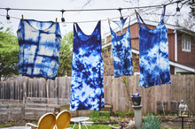 Tie Dyed Clothes Hanging On A Clothes Line.