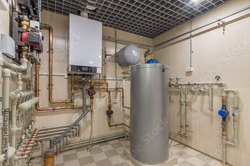 Hot water thermal storage tank. Gas Boiler room with a heating ...