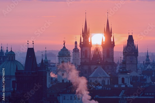 Staande foto Praag Rising Sun behind the Prague Towers
