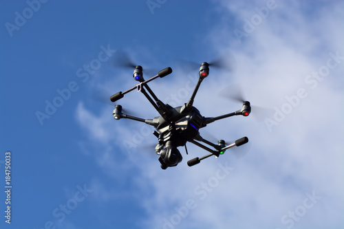 Fototapeta Large Drone - Police & Emergency Service Use  - Airport Incursions - Survey Drone at Altitude - Video and Photographic Platform - Emergency Services Crowd Monitoring - Unmanned Aircraft System obraz