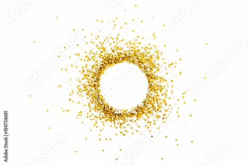 Obraz Golden shiny confetti on a white background. Round frame made of confetti. Festive confetti. - fototapety do salonu