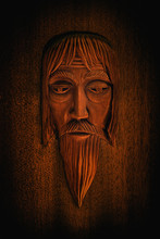 Carved Wooden Mask Of An Old M...