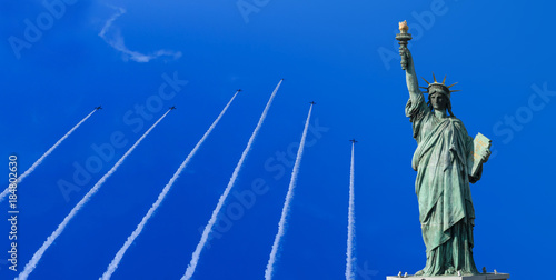 Fotografie, Obraz  Statue of Liberty with airplane cloud background