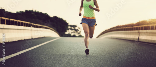 Fotografie, Obraz  young fitness asian woman runner running on city road