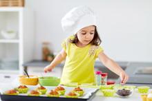 Little Girl In Chefs Toque Bak...
