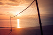 Valleyball net on the beach with beautiful seasacpe view and sunset light in twilight time at Chao Lao Beach, Chanthaburi Province, Thailand. (Selective focus)