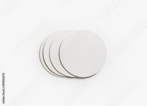 Photo of blank beer coasters on white paper background. Template for your design. Flat lay.