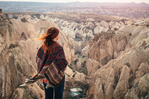 Foto op Canvas Zalm Turkish Cappadocia rock formation landscape observed by young fe