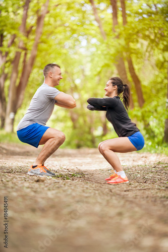 Obraz Fitness couple stretching outdoors in park - fototapety do salonu