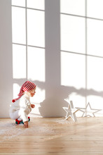 Playful Small Child Wears Sant...