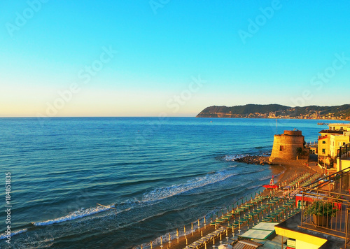 Photographie  View of the Ligurian Sea, the beach in Alassio (province of Savona) at sunset, t