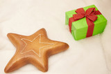 Fototapeta Do akwarium - Gifts and gingerbread star is a sign of the upcoming Christmas.