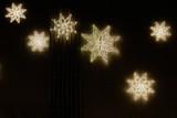 Fototapeta Do akwarium - Glowing stars are a perfect Christmas illumination.