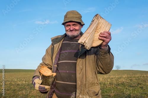 Fotografie, Obraz Villager Showing off his Firewood