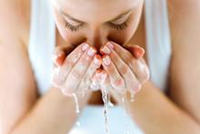 Beautiful Young Woman Washing ...