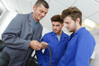 teacher with students in mechanics working