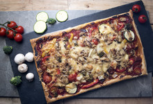 Cooked Pizza With Surrounding Vegetables