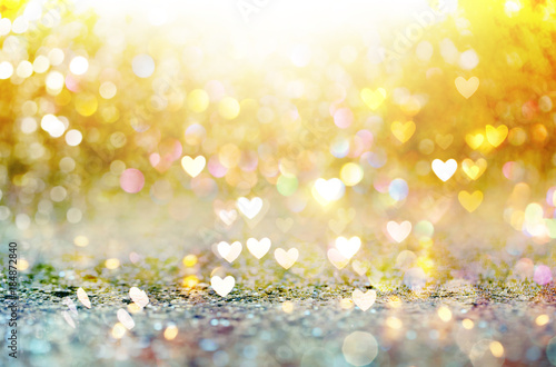 Beautiful shiny hearts and abstract lights background Poster Mural XXL