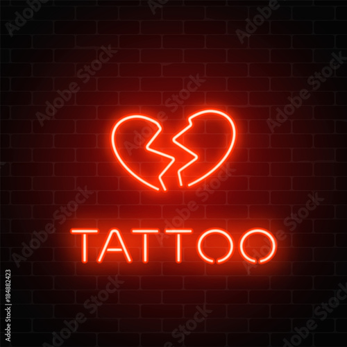 Tattoo parlor glowing neon signboard with emblem Canvas Print