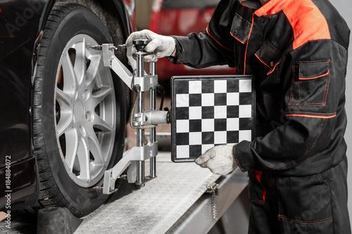 auto mechanic sets the car for diagnostics and configuration Wallpaper Mural