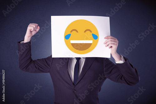 Staande foto Vlees Businessman holding paper with laughing emoticon