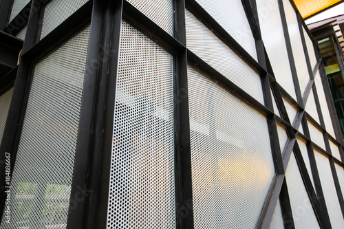Fotografia, Obraz  Perforated sheet of metal texture and black steel background