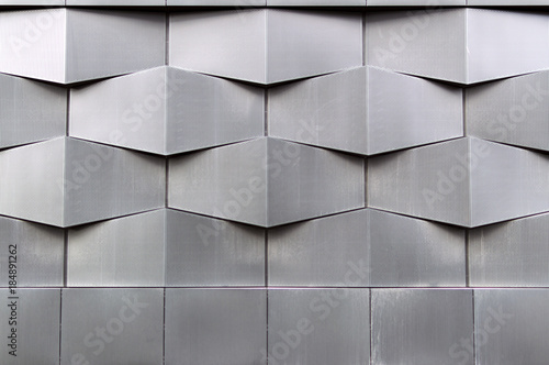 Close-up of gray geometric building facade
