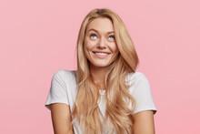 Cheerful Blonde Female Looks U...