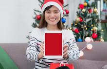 Woman Wear Santa Hat Holding T...