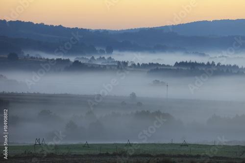 Foto op Plexiglas Historisch geb. Fields and meadows under early morning fog - Podkarpacie region, Lesser Poland province, Poland, near cities of Rzeszow and Krosno