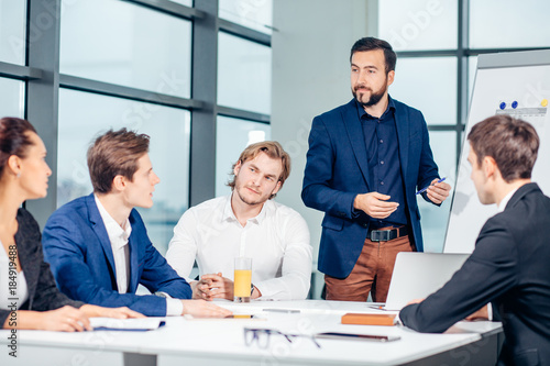 Fototapeta business, technology, people, deadline and team work concept - smiling male boss talking to business group at office background obraz na płótnie