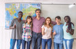Portrait of schoolmates with teacher in the classroom