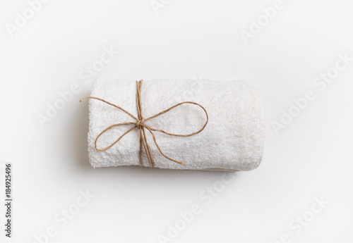 Fényképezés Blank towel tied with a rope on white paper background