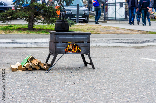 Street brazier with scorching fire. Cooking food and tea. A street stove with fire.