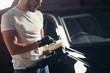 auto mechanic worker prepare for polishing car by power buffer machine