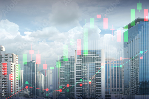 Double exposure of view of cityscape and stock market or financial graph for financial investment concept