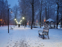 Snow-covered Bench In The City...