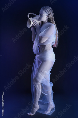 Beautiful young woman with amazing body-art as Aquarius against dark background Canvas Print