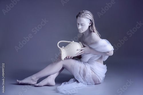 Beautiful young woman with amazing body-art as Aquarius against grey background. Zodiac signs concept