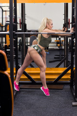 attractive yang girl training spot body in gym fitness hard exercies