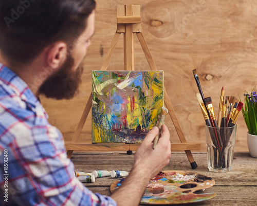 Artist painting abstraction, oil paints color on canvas
