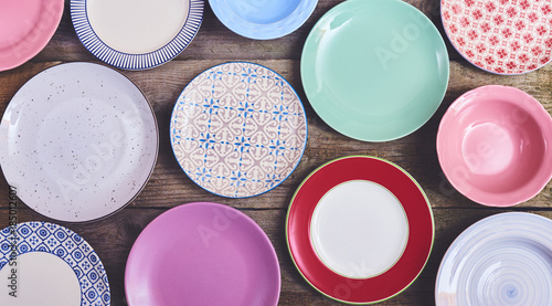Set of different colorful dishes over wooden board Wallpaper Mural