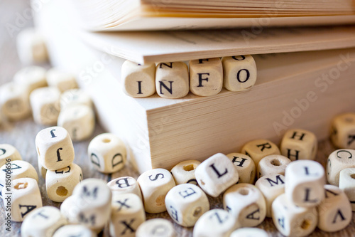 school and education - literature and knowledge - open book with INFO text, wood Poster